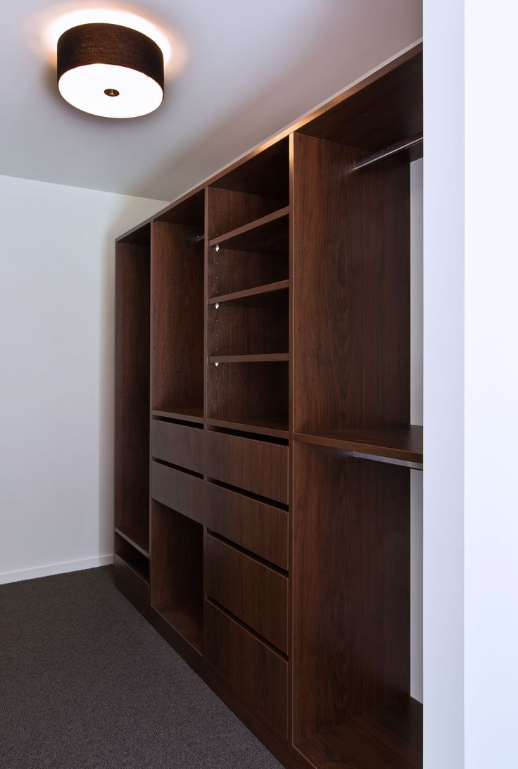 The master bedroom walk in wardrobe offers plenty of storage.