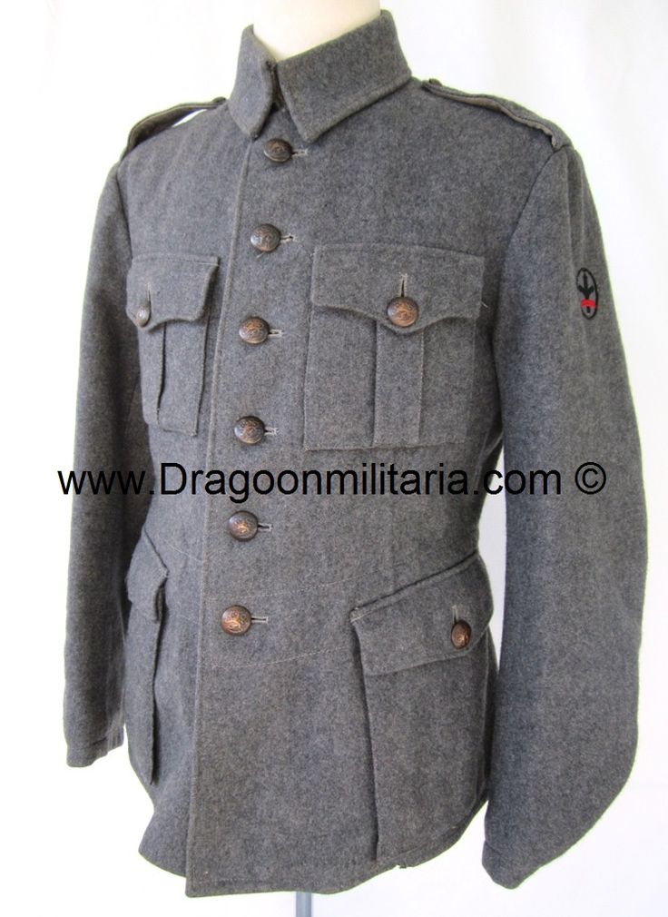 Grey wool  jacket with unit insignia at sleeve. Unit patch for nfantry regiment 45. JR45 was part of 8th Division. Marked 52 A, Int, M(sold) stamp. No year markings but early shoulderboards note year c.1940. Green collartabs removed. Dark grey metal buttons.