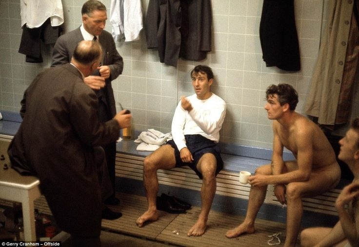 Tottenham manager Bill Nicholson stands beside Jimmy Greaves as he talks with the club physio and Ron Henry (far right) enjoys a cup of tea