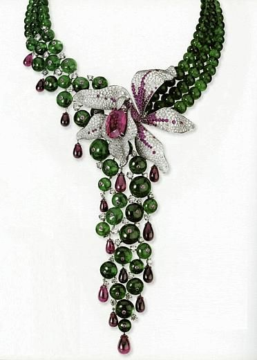 Cartier.  Caresse d'orchidées collection | diamonds, rubies, rubelite center, 189 'pearls' of 656 carats of emeralds in white gold.