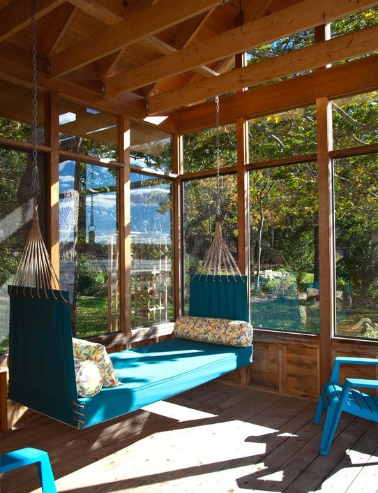 Patio with Adams Mfg Corp Teal Resin Stackable Adirondack Chair, Penobscot Bay Porch Swings - The Camden