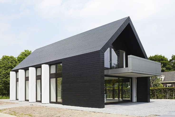Is this a modern day take on the barn? Fabulous contemporary lines seen in this recent build in Holland.