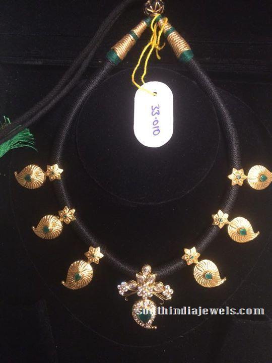Black thread gold emerald mango necklace