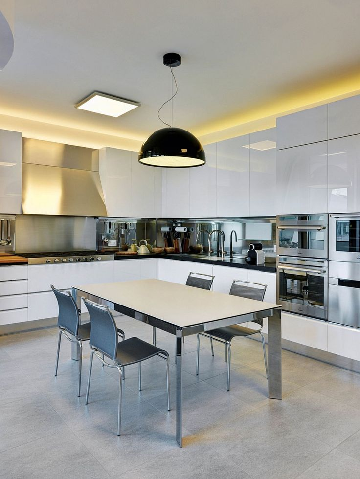 Apartments:Extraordinary Oversized Pendant Light In Black Color In The Apartment Kitchen With Sleek Dining Sets With White Cabinets Also Stainless Steel Arch Faucets Sink Stove Also Oven Also Backsplash Modern Interior Design of Luxury Apartment in Milan To Inspire You