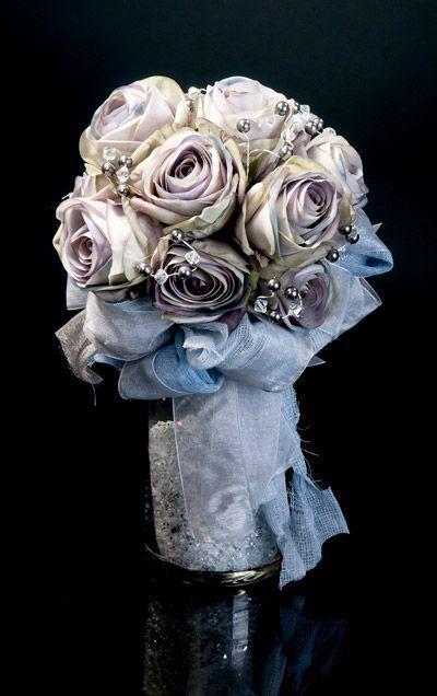 "Little Bouquet Shop's Silk Bouquet, ""Corpse Bride"" (has matching boutonniere) something like $150"