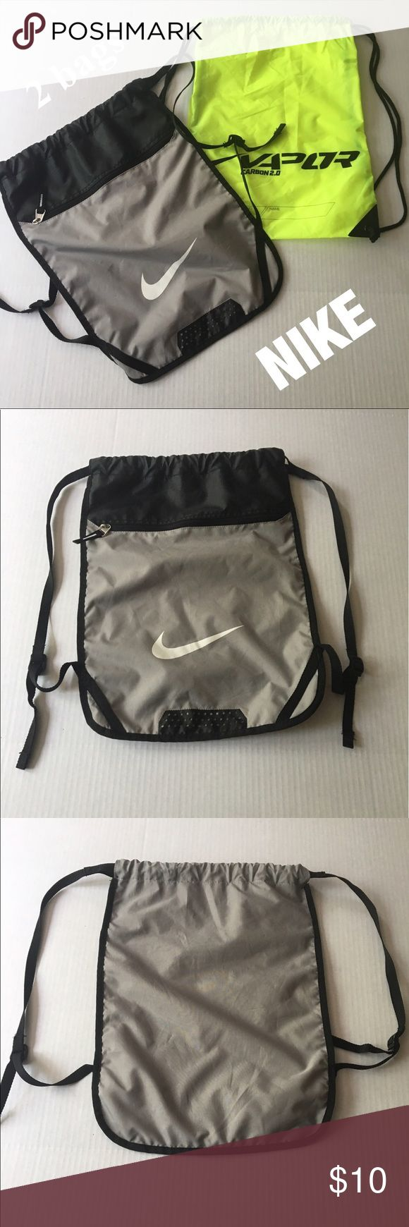 Nike sport bags 2 Nike brand sport bags! Sold together. The gray one is more heavy duty and the green is lighter and thinner. Both pull straps, the gray with adjustable straps and additional pockets inside and out!! Nike Bags