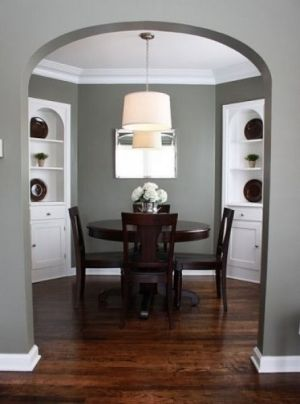 Love the gray walls, white accent/ceiling and dark wood.