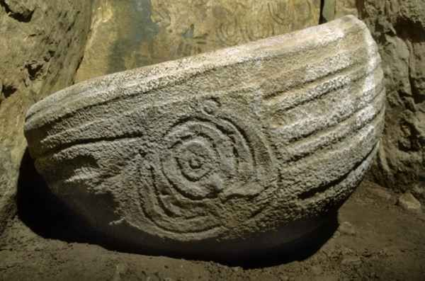 A granite basin located within the great Neolithic tomb at Knowth, Co. Meath, Ireland. Covered in megalithic art it held cremated human bone.