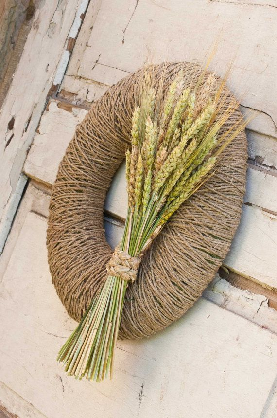 Wreath wrapped with linen cord with a bouquet of dried rye and field grasses - simple but elegant.