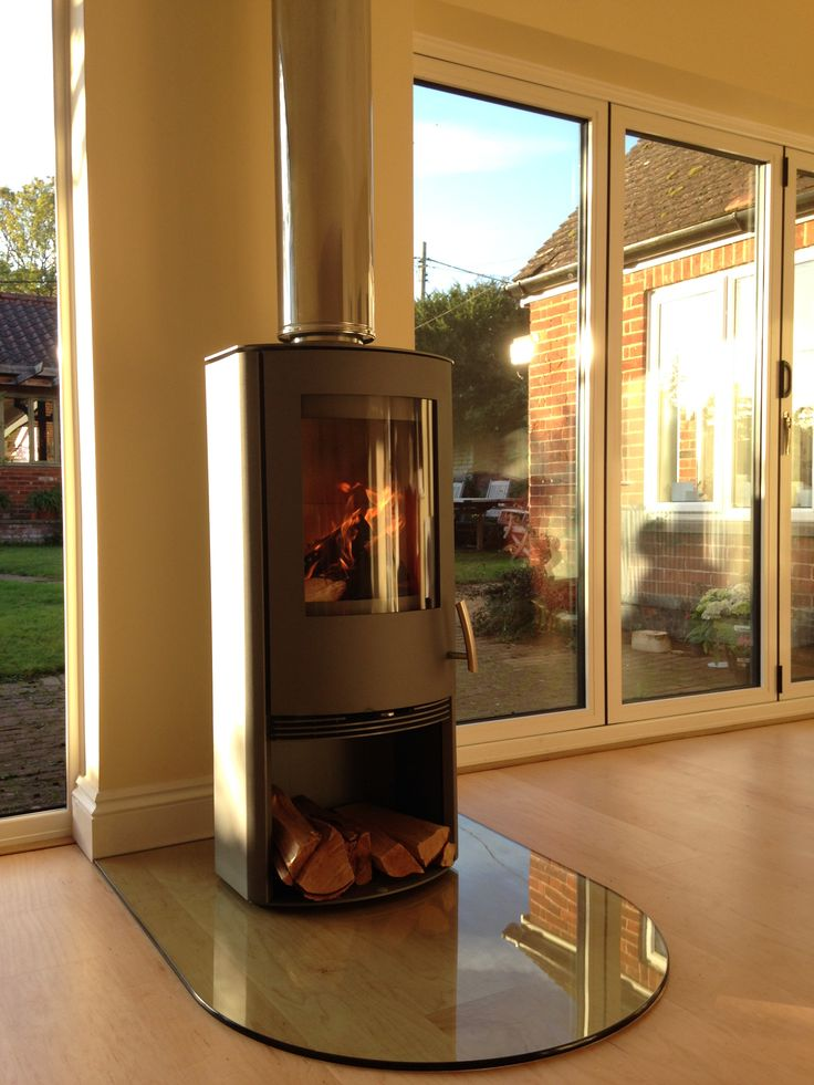A lovely Termatech TT20 in silver on a D Shaped clear glass hearth.
