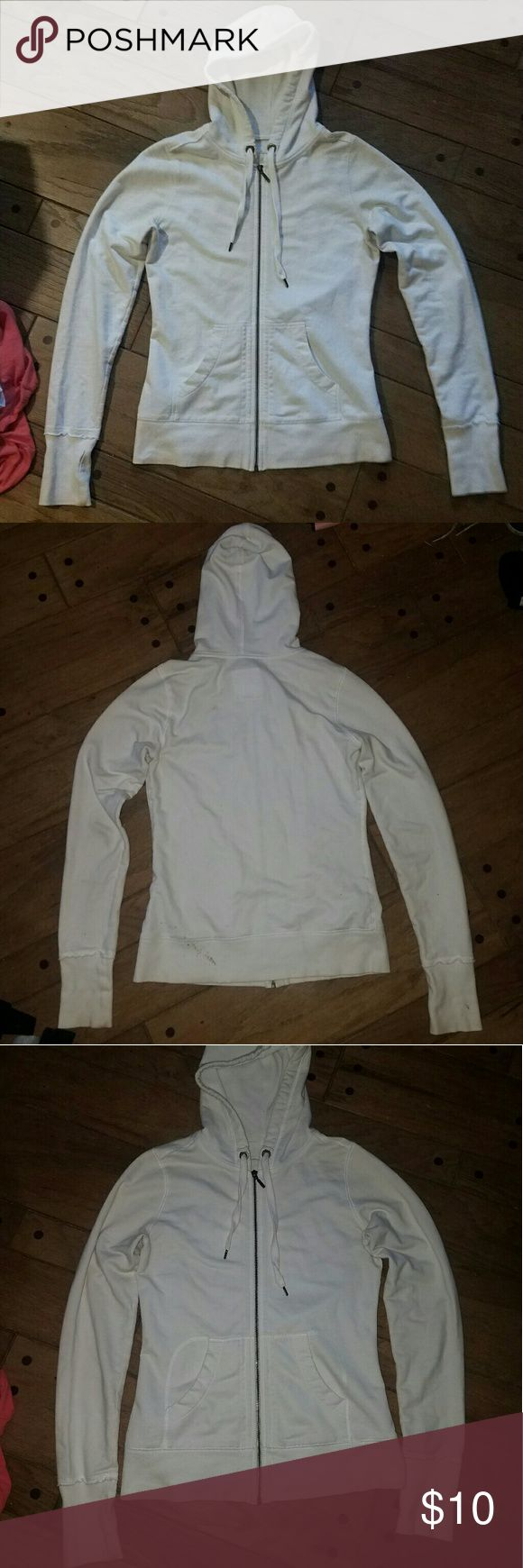 White Zip Up Hoodie Size small full zip up hooded sweatshirt by Merona. White sweater hoodie jacket. Stretchy material and a long fit. Drawstrings on hood, thermal type lining inside the hood. Super cute white hoodie!!! Some discoloration at the wrists, from wear. I'm sure it will come out and brighten up when bleached with other whites!! Otherwise in excellent condition!! Nice high quality hoodie, with a flattering fit. Merona Tops Sweatshirts & Hoodies