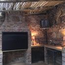 Treelands Castle. Covered braai area with build-in braai and TV. Dullstroom Accommodation.