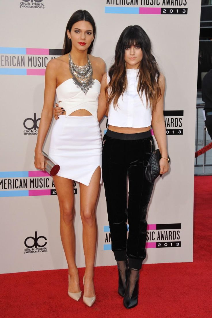 Could Kendall Jenner's skirt be any shorter? The newly 18-year-old model isn't afraid to flash a little skin -- not to mention a peek of midriff -- in a white-hot dress ... and apparently neither is her younger sister Kylie, who coordinates in a matching white crop top and velvet pants.