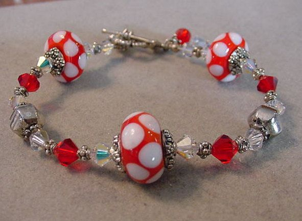Red Polka Dot Bracelet with Swarovski Crystals Minnie Mouse polka dot Lampwork Beaded bracelet by Magicclosetbling on Etsy