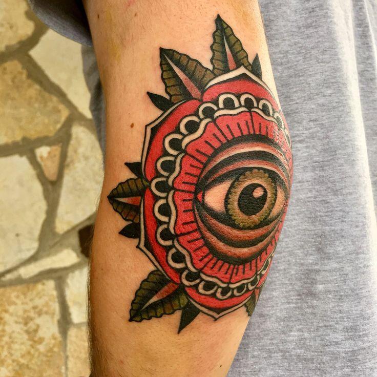 Eye elbow tattoo