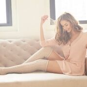 A pale pink silk robe, worn with high kneed white socks by The Lemon Collection