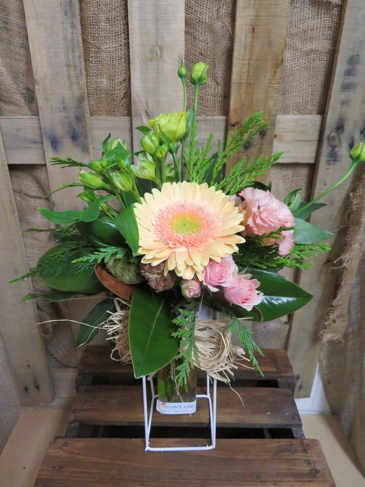 Sweet floral arrangement made into a keepsake vase. Lovely soft colours created at Florist ilene