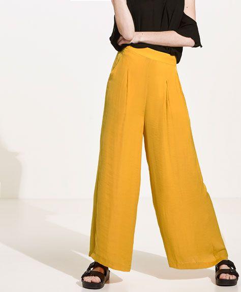 Pantalón satinado ancho amarillo - Novedades - Tendencias primavera verano 2017 en Oysho online. Compra los bikinis, bañadores, pijamas, sujetadores o ropa deportiva más soft & chic.
