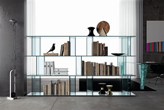 'Inori' The versatility and assembly possibilities  allow the utilization as a show-case, display-case, TV-unit. Available the free-standing version and wall unit. The uprights are freely adjustable on each shelf through sliding rails and fixing device. All the uprights are are available in 32 and 42 cm height. Shelves and bases also available in glass lacquered ebony. Slides in anodized black aluminum.