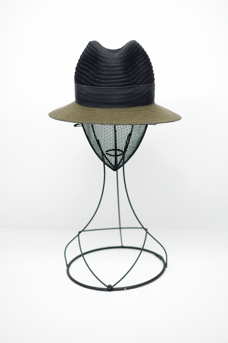 This is an Outdoor Fedora hat and unisex .  Handmade on a wood block . This crown is my original design handcrafted  from La Forme , Paris.  The crown is a top stitch covered 3D Spacer mesh  Trimmed with a gros grain in cotton. The brim is top stitch circular.  Height of the crown is 10 /11/9 cm Brim is 7,5 cm all round with a fur hem stitch on the edge This wool felt is made in USA