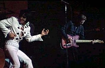 Elvis and James Burton, lead guitarist, live at the International, August 12, 1970 (mid-night show)