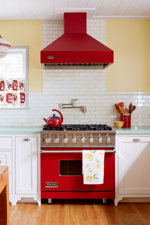 The kitchen in this California home was enlarged by combining it with the formal dining room and updating it with fresh takes on vintage country style—all while maintaining the space's original yellow-and-red color scheme.
