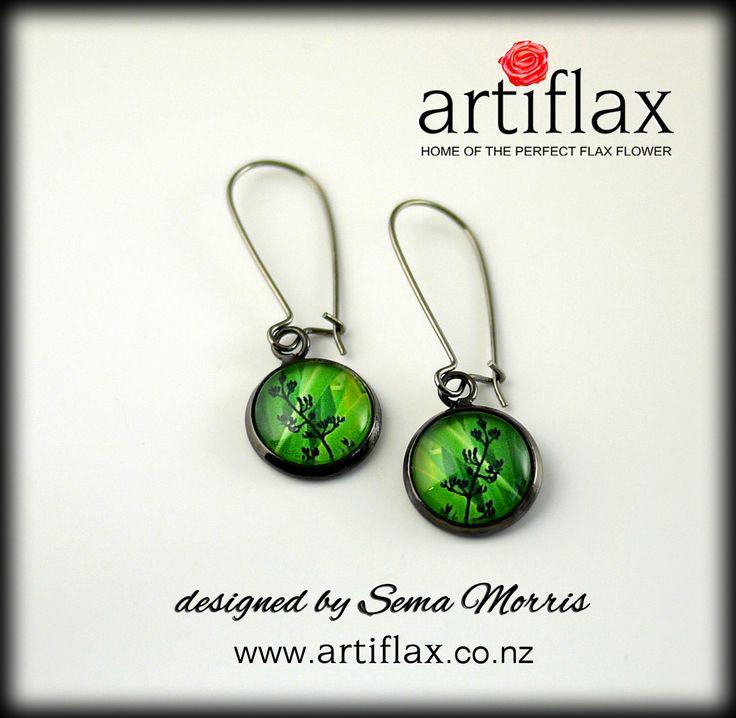 Emerald Harakeke dome earrings.  Original artwork by Sema Morris
