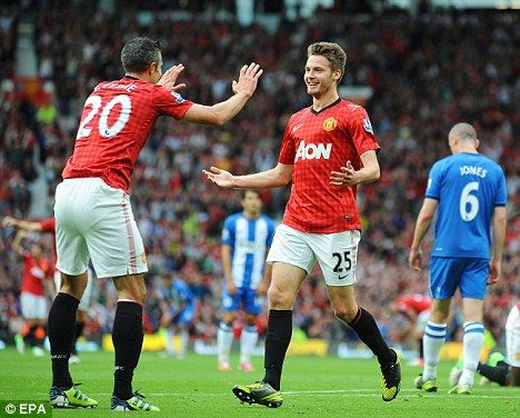 Dream start: Nick Powell celebrates with Robin van Persie after scoring on his debut