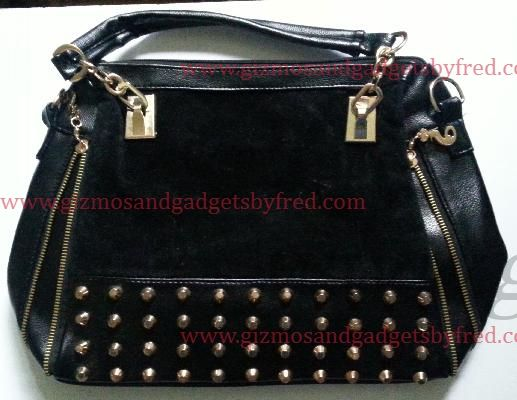 Nice stud purse.Black and Gold. Long shoulder strap included.New. Very nice. www.gizmosandgadgetsbyfred.com