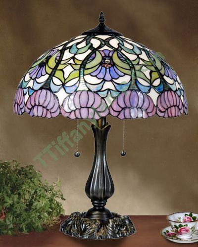 Tiffany lamp..reminds me of a lamp my Grandma had.  So pretty<3