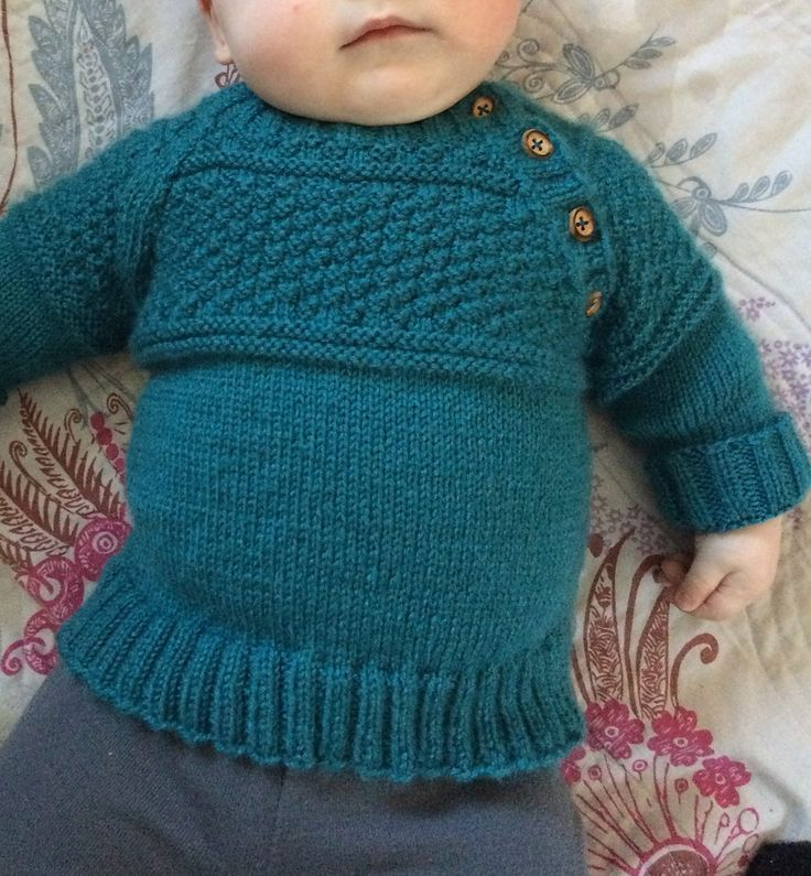 Free Knitting Pattern for McDreamy Jumper - This pullover has a textured yoke and buttons along the edge of the raglan sleeve for easy dressing. Sizes 1/3 – 6/9 – 12/18 months (2 – 3/4) years. Designed by DROPS Design. Available in many languages. Pictured project by Fraugee728.