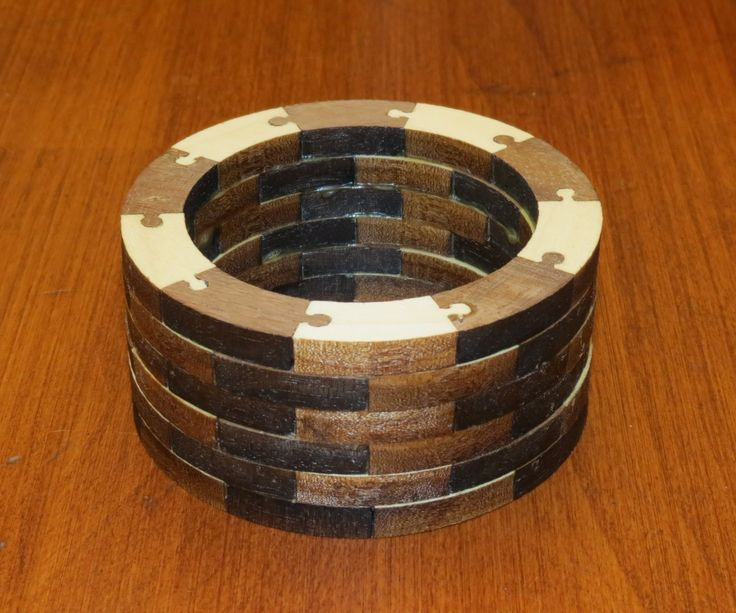 Segmented turning features a turning blank made up of small stacked pieces of wood of various species for a unique appearance.
