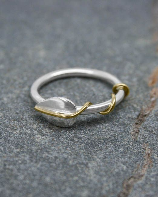Handmade silver leaf ring with brass tendrils wrapped around a silver wire band.  #brass #handmade #leaf #ring #silver #starboardjewellery #jewellery #cornwall #uk #gb #westcountry #devon #england #silversmith #pretty #jeweller #jewellers #handmadejewellery