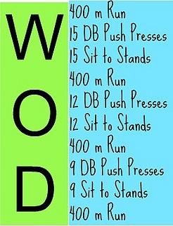 400 m run, 15 DB Push Presses, 15 Sit to Stands, 400 m run, 12 DB Push Presses, 12 Sit to Stands, 400 m Run, 9 DB Push Presses, 9 Sit to Stands, 400 m Run