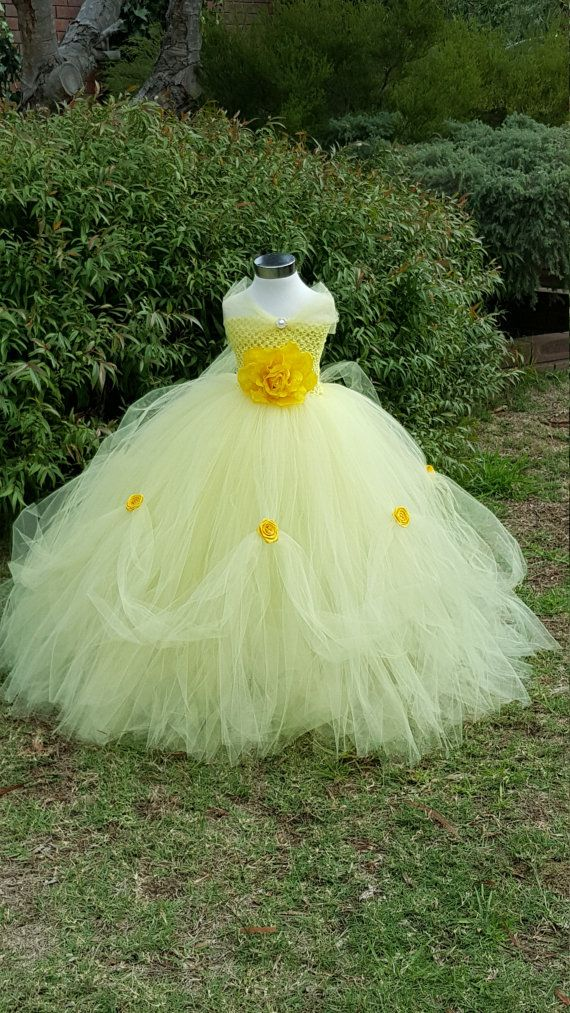 Welcome to Baby/Infants Clothing by Funkids&Us Boutique   Every Little girl dream to be a Disney princess-!!! Everyone knows princess Belle the Character in Famous Disney movie beauty and the beast fairy tale. This beautiful handmade Princess belle inspired tutu dresses is perfect for birthdays parties or any occasion. This dress is absolutely beautiful and every little Girl definitely love to wear it. It is made of light yellow soft Premium tulleThe crochet bodices is accented with vintage…