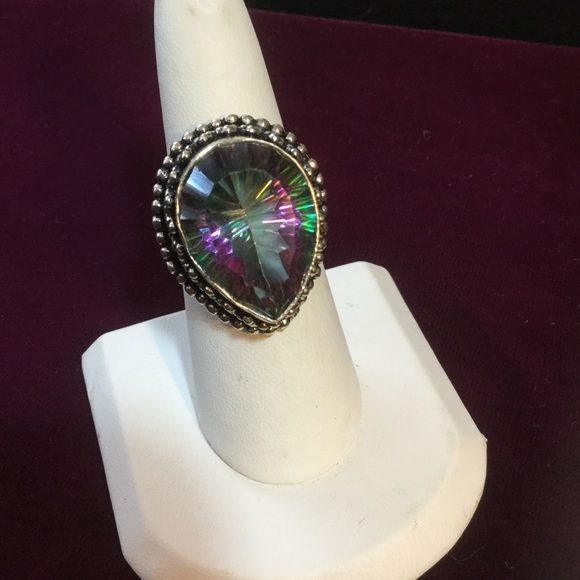 MYSTIC  FIRE  TOPAZ  9.25 ring Trillion cut pear shaped Mystic Fire Topaz ! Steering silver. WOW  !  I always loved unusual things as you can see.  No,  you are not seeing things.  This can be yours,  cause the Praline Queen has too many things. Jewelry Rings