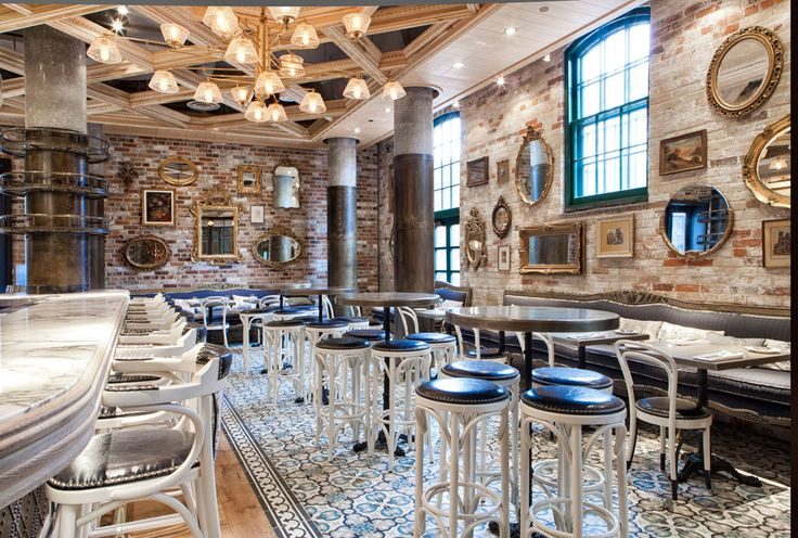 Cluny Bistro in the Distillery - French bistro in Toronto | Exposed brick walls, coffered ceilings, blue, white and gold colour scheme. Just love!