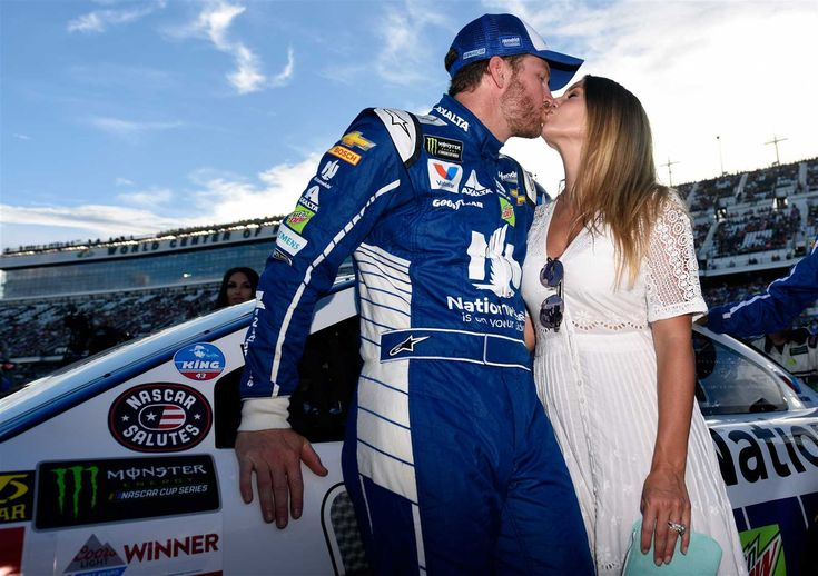 At-track photos: Daytona weekend Sunday, July 2, 2017 Dale Earnhardt Jr., driver of the No. 88 Nationwide Chevrolet, and his wife, Amy, kiss on the grid prior to the Monster Energy NASCAR Cup Series 59th Annual Coke Zero 400 Powered By Coca-Cola at Daytona International Speedway on July 1, 2017 in Daytona Beach, Florida. Photo Credit: Jared C. Tilton/Getty Images Photo: 27 / 85