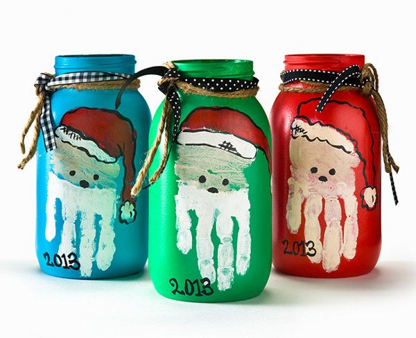 If you love Santa crafts and Mason jar crafts, you're in luck! Combine two of your favorite projects into one when you make a set of these Handprint Santa Mason Jars.