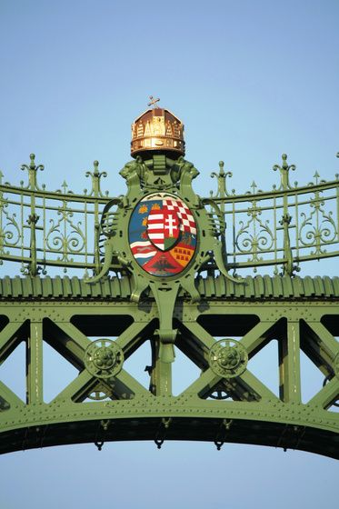 The coat of arms of Hungary visible in the centre of Liberty Bridge, (Szabadság-híd), Budapest, Hungary.