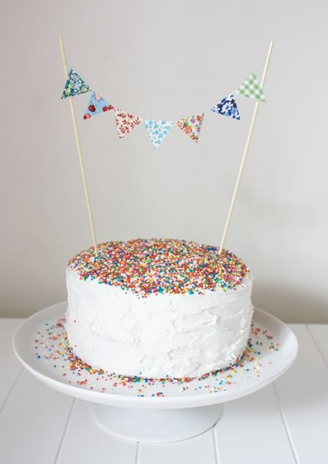 Hundreds and Thousands Bunting Cake - this is so simple and yet so amazingly gorgeous  Google Image Result for http://twirlingbetty.files.wordpress.com/2010/09/multi-coloured-bunting.jpg