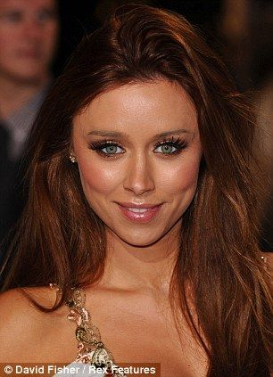 Blue-eyed Una Healy's red hair stands out against her pale face without her usual bronze glow