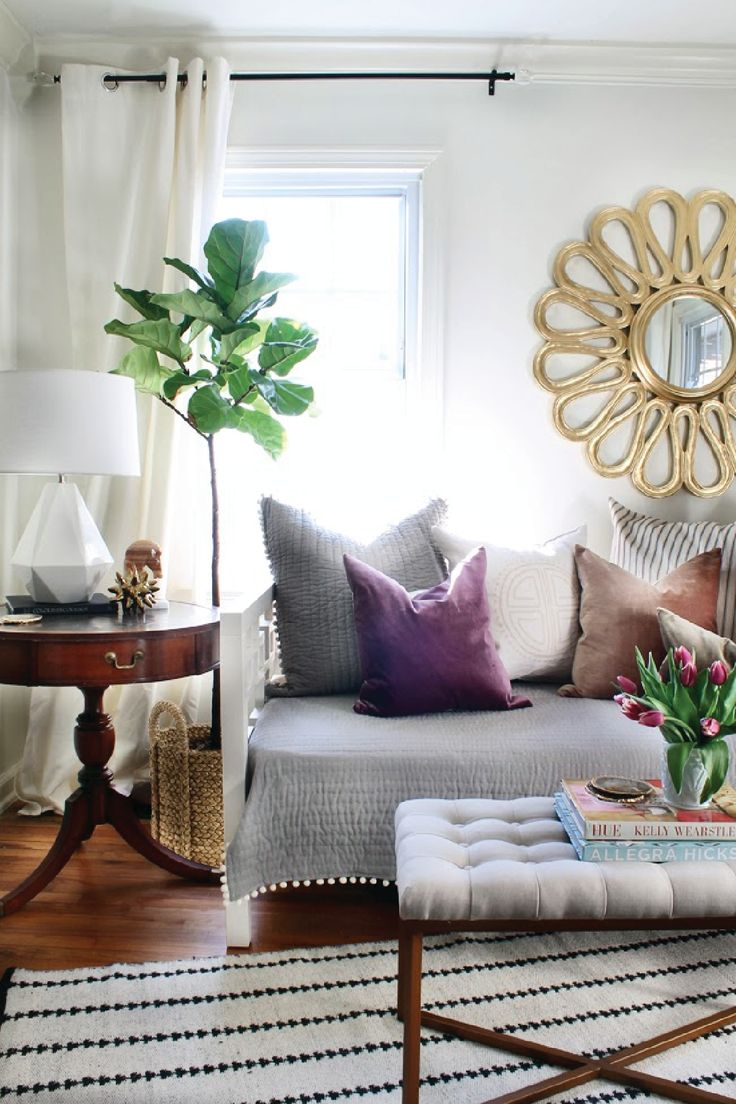 Create a relaxing space in your home by pairing gorgeous neutral linens with some pops of unexpected accent colors, like gold and purple. Bring the spring weather indoors with some fresh flowers and potted plants—the room will look and smell amazing!