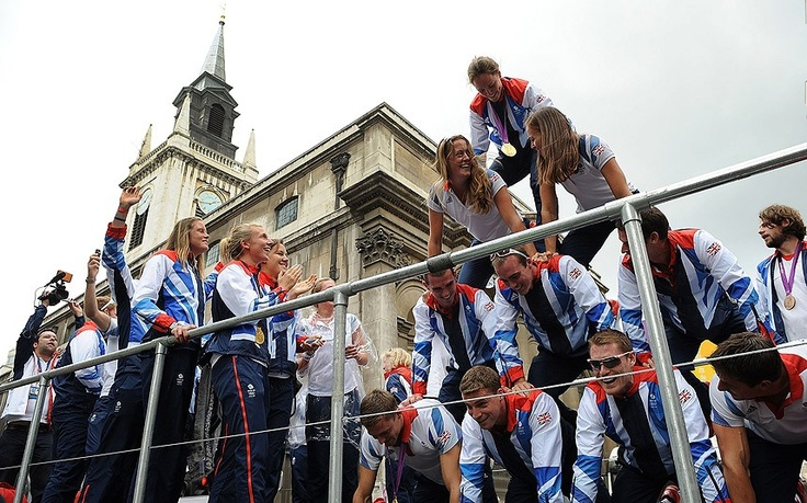 Members of the Rowing team create a pyramid during the London 2012 Victory Parade for Team GB and Paralympic GB athletes
