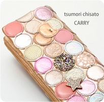 i am on a wallet hunt and I keep going back to tsumori chisato......