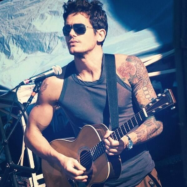 John Mayer. Don't get much more attractive than a man with tattoos and a guitar.