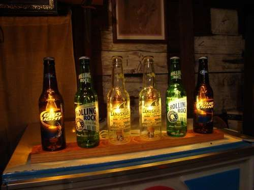 This is a beer bottle version of the classic color organ, where different color lights are triggered by different frequencies of sound, resulting in a display that flashes along to music.