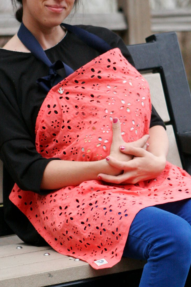 Breathable Stylish Nursing Tent in Coral & Navy by MamaWraps - I really like the plain colour, no crazy patter, and how the eyelet fabric makes it breathable for baby. Could be bought or easily made.