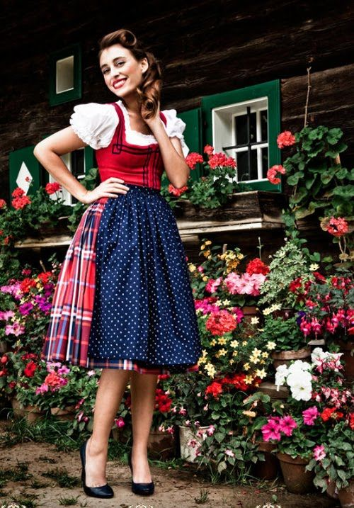 There's something so fun about a big, bold plaid print being used for the skirt on a dirndl. #plaid #red #blue #dirndl #dress #folk #costume #German #clothing