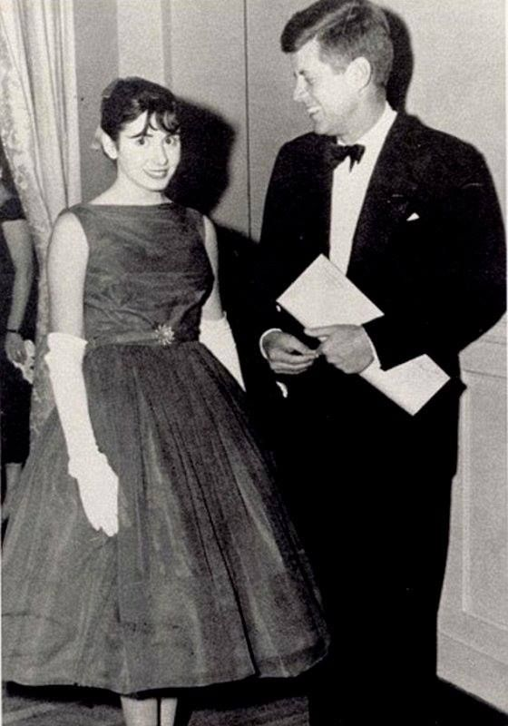 Here's Nancy Pelosi as a young woman, posing with President Kennedy at his inauguration.